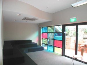 Bright glass library entrance at Sydney Grammar Prep